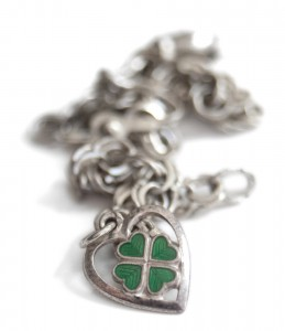 Amulets: Good luck charms from around the world. Four leaf clover charm.
